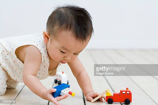 Asian boy playing with toys