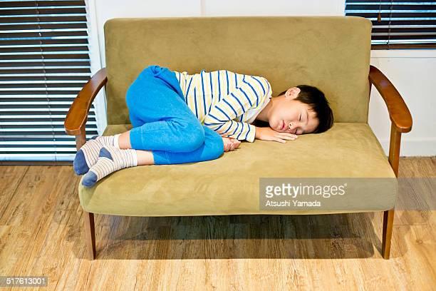 Asian boy sleeping on sofa