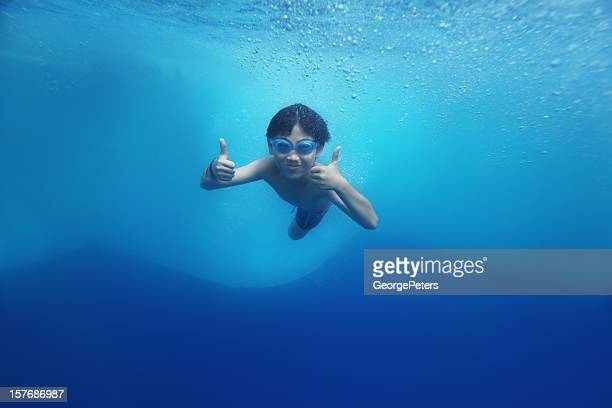 Asian Boy Swimming Underwater