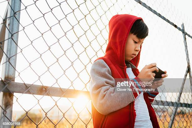 Asian boy with smartphone.