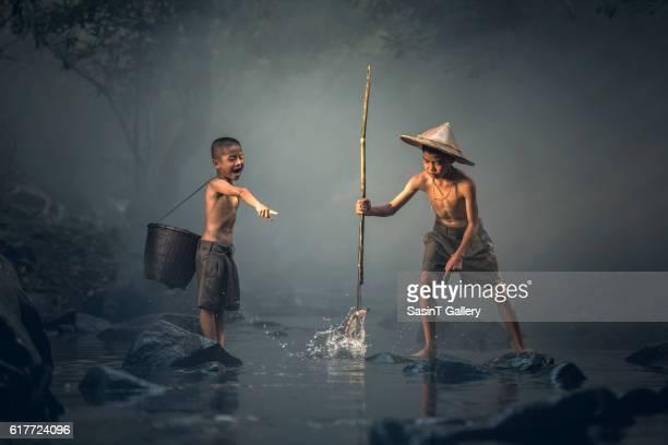 Asian boys fishing