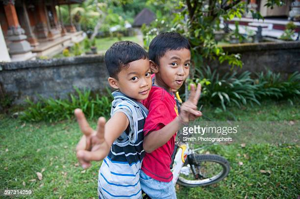 asian boys playing in backyard - indonesia stock pictures, royalty-free photos & images