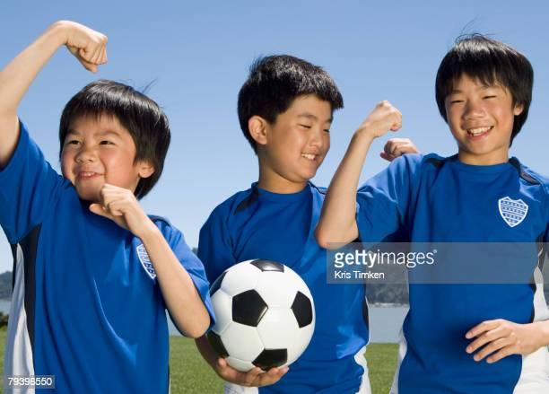 Asian boys with soccer ball