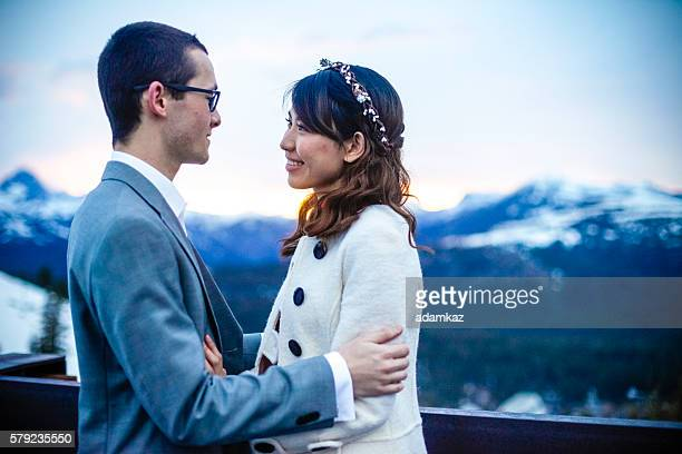 Asian Bride and Caucasian Groom on Wedding Day in Mountains