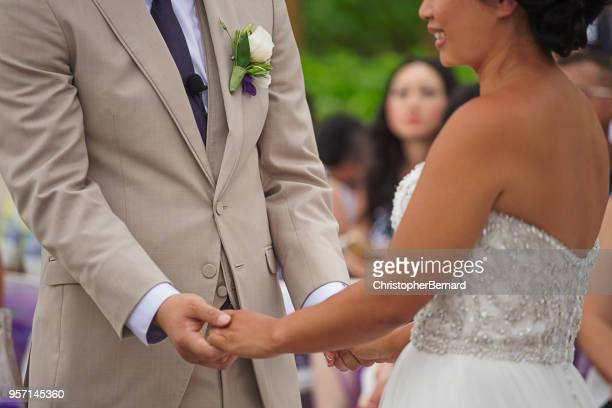 asian bride and groom at altar - wedding vows stock pictures, royalty-free photos & images