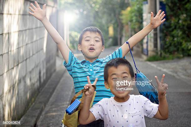 Asian brother play on the playground