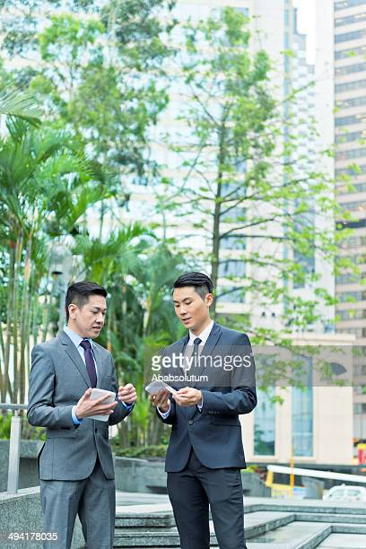 Asian Business Associates Using Mobile Devices, Hong Kong, China