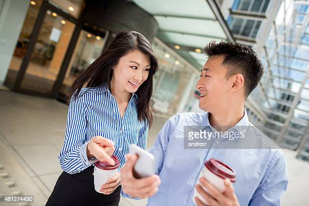 Asian business couple working together outdoors