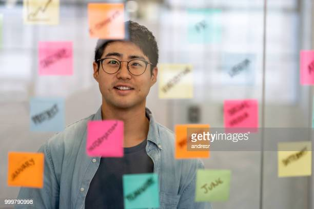 asian business man brainstorming at a creative office - business plan stock pictures, royalty-free photos & images