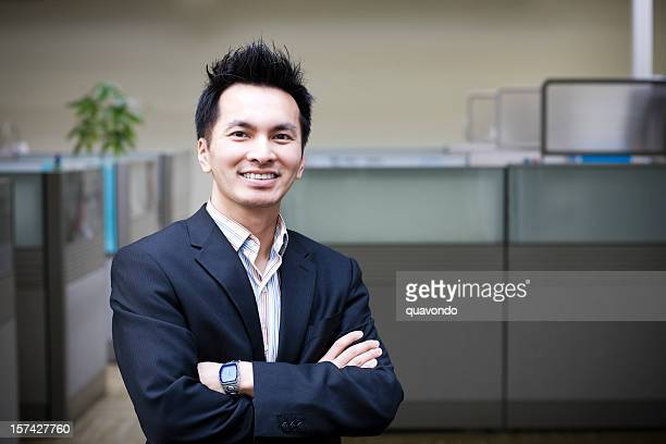 asian business man crossing arms by office cubicles, copy space - vietnamese ethnicity stock pictures, royalty-free photos & images