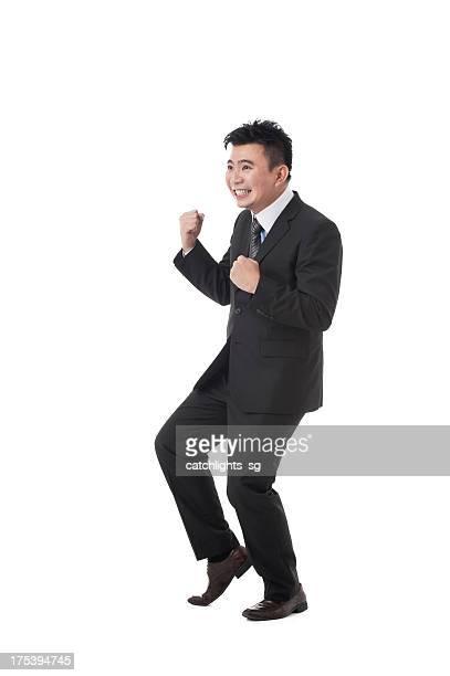 アジアビジネスの男性 - ガッツポーズ ストックフォトと画像