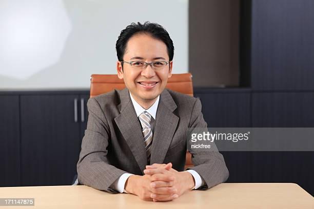 アジアのビジネスの男性のポートレート笑顔