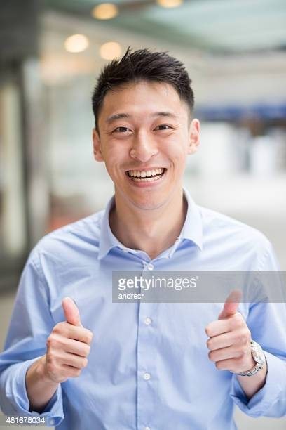 Asian business man with thumbs up