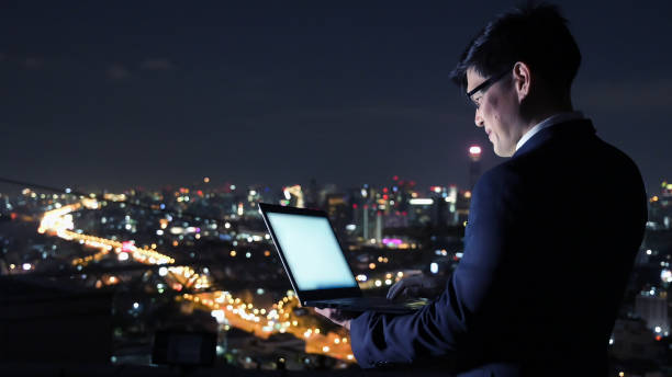 Asian business man working with laptop at night