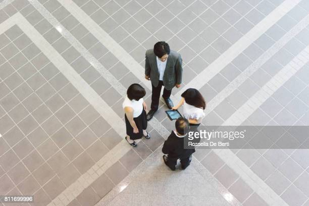Asian business people having a meeting on the go