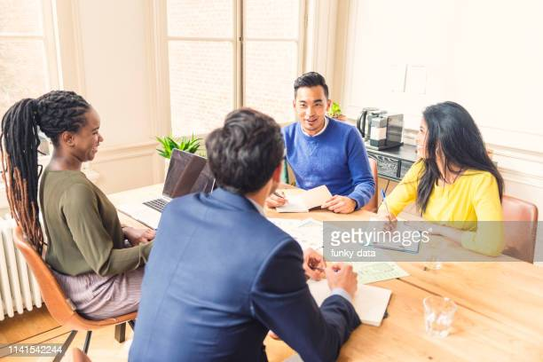 asian business professional explaining - minority groups stock pictures, royalty-free photos & images