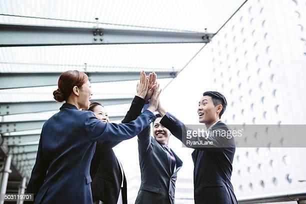 Asian Business Team High Five