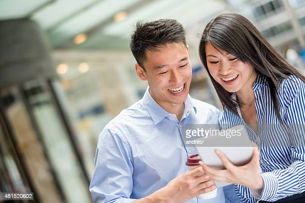 Asian business team using a tablet computer