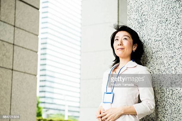 Asian business woman in city location