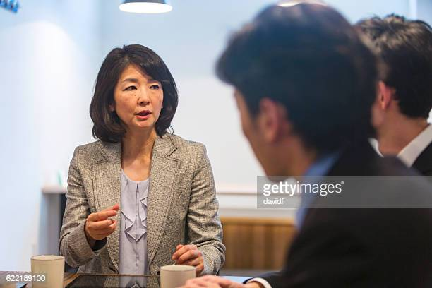 Asian Business Woman Managing a Corporate Meeting in Japan