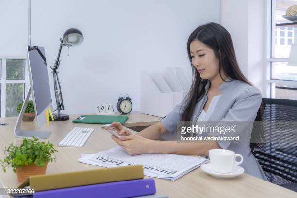 asian business woman talking to her colleagues about plan in video conference. business team using computer for a online meeting in video call. group of people smart working from home. - workers compensation stock pictures, royalty-free photos & images