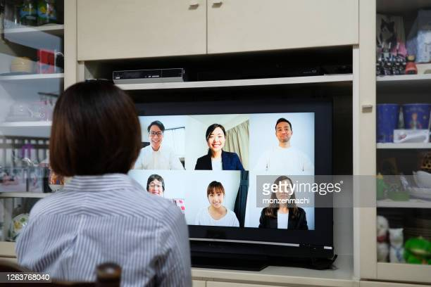 asian business woman working at home and talking to colleagues on video conference - only japanese stock pictures, royalty-free photos & images