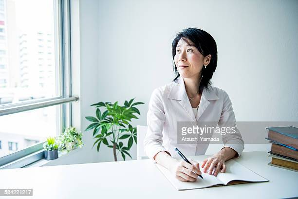 asian business woman working in office - only japanese stock pictures, royalty-free photos & images