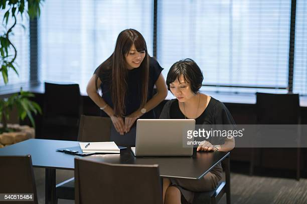 Asian business women working at the office