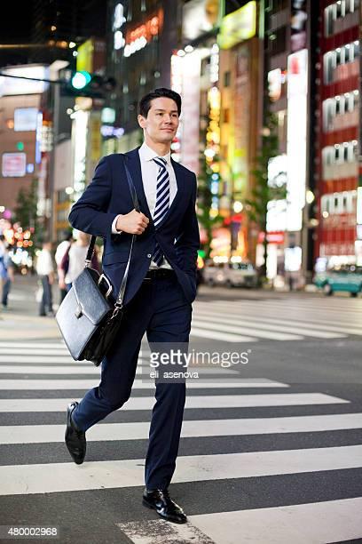 Asian businessman crossing street in Shibuya, Tokyo