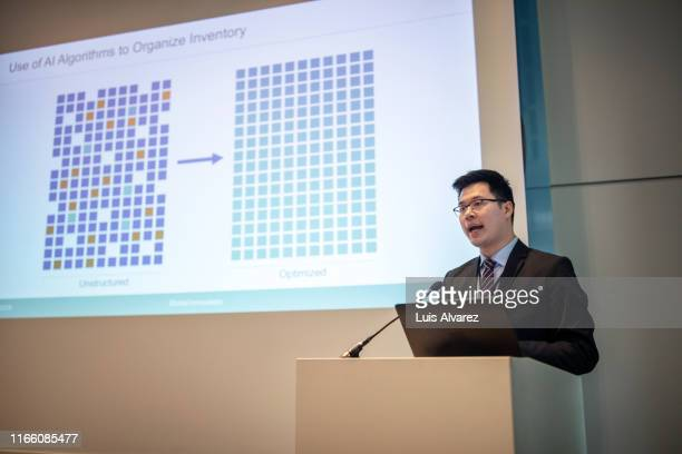 asian businessman giving presentation at convention center - convention center stock pictures, royalty-free photos & images
