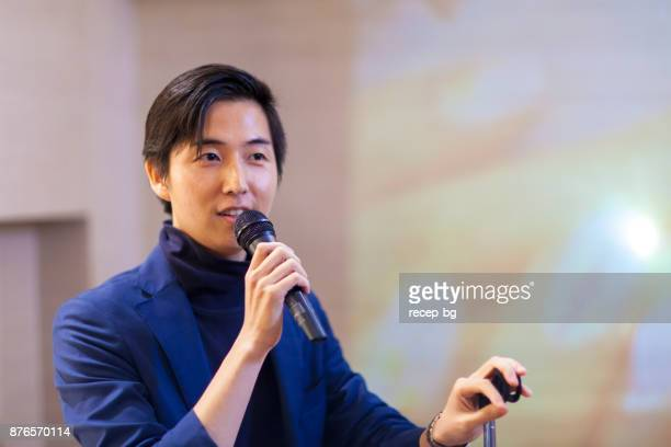 asian businessman giving presentation - press conference stock pictures, royalty-free photos & images