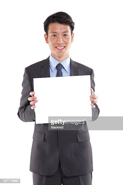 asian businessman holding a blank sign - person holding blank sign stock pictures, royalty-free photos & images