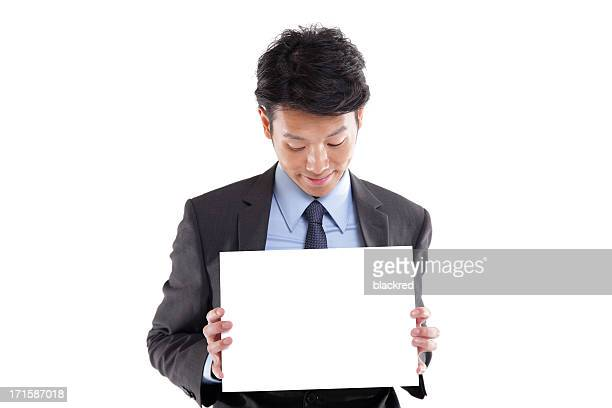 asian businessman holding a blank sign - blank sign stock photos and pictures