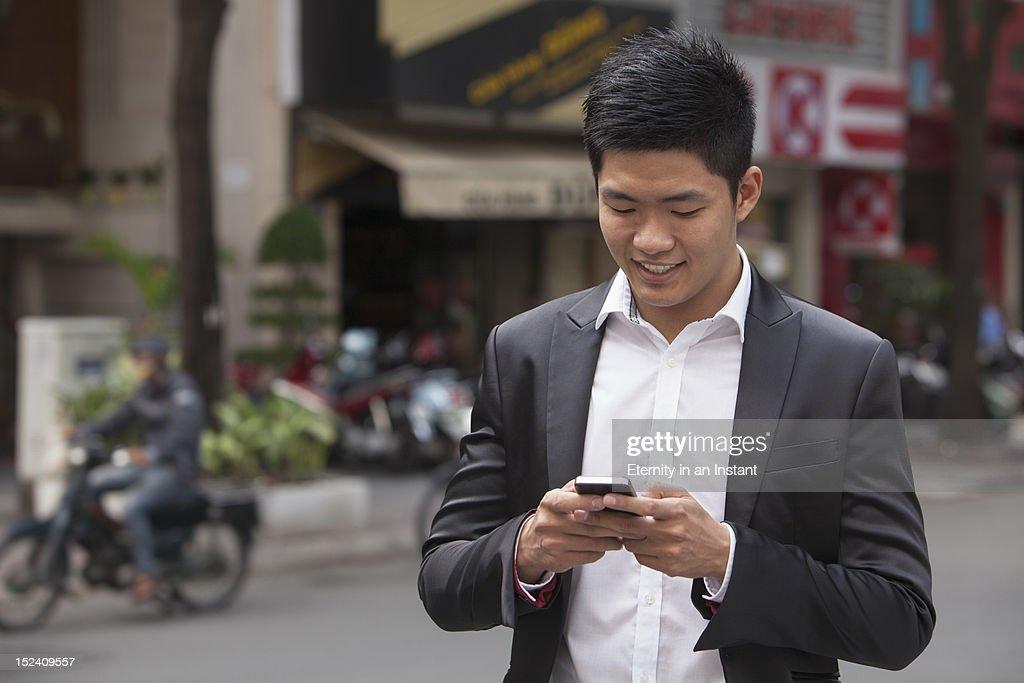 Asian Businessman holding smartphone : Stock Photo