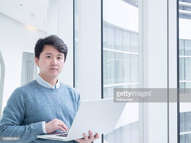 Asian businessman in office