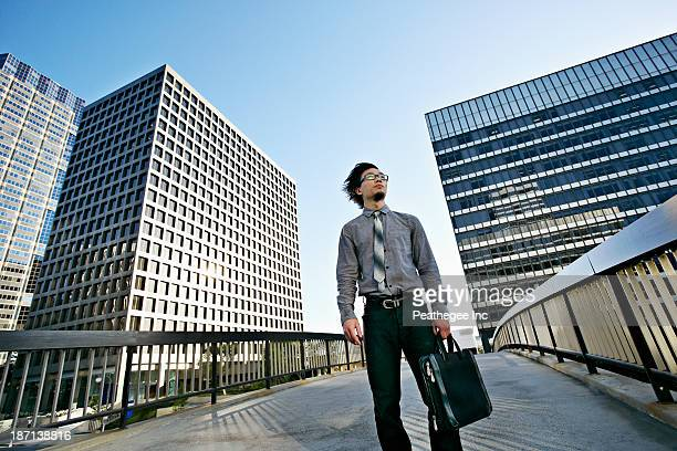 Asian businessman on urban walkway