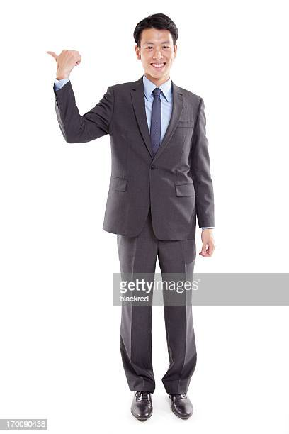 Asian Businessman Pointing to his Right