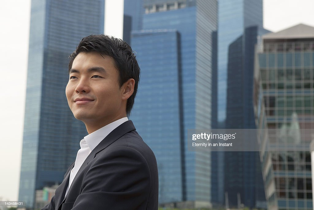 Asian Businessman smiling in city : Stock Photo