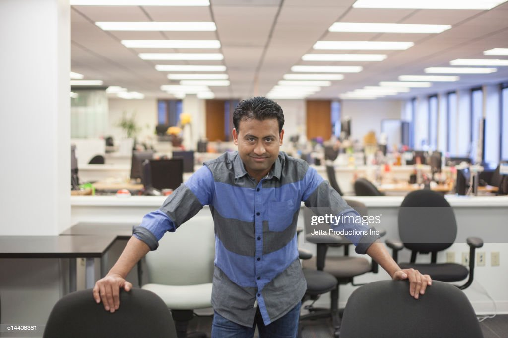 Asian businessman standing in office : Stock Photo