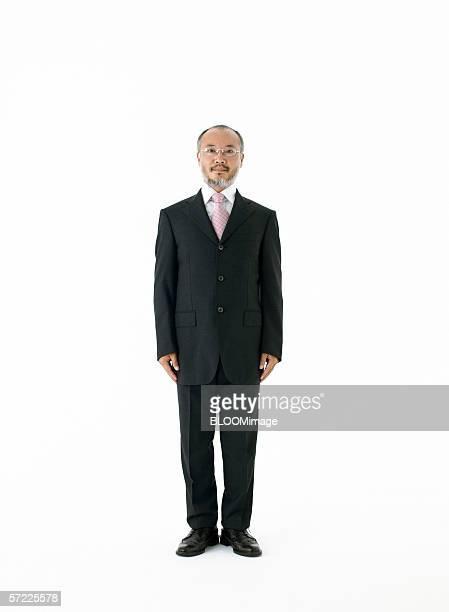 Asian businessman standing straight