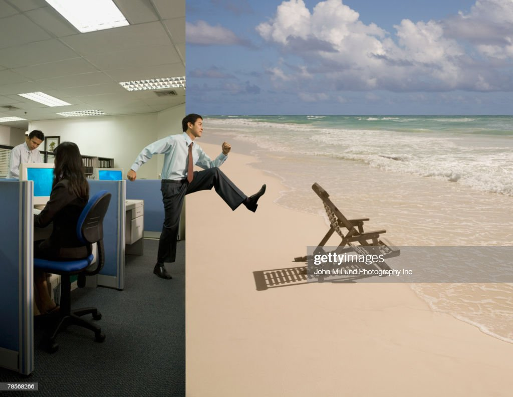 Asian businessman stepping from office to beach : Stock Photo