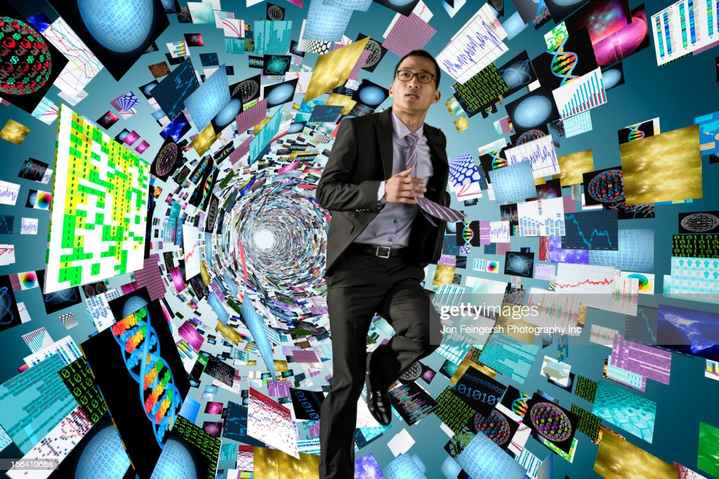 Asian businessman surrounded by science images : Stock Photo