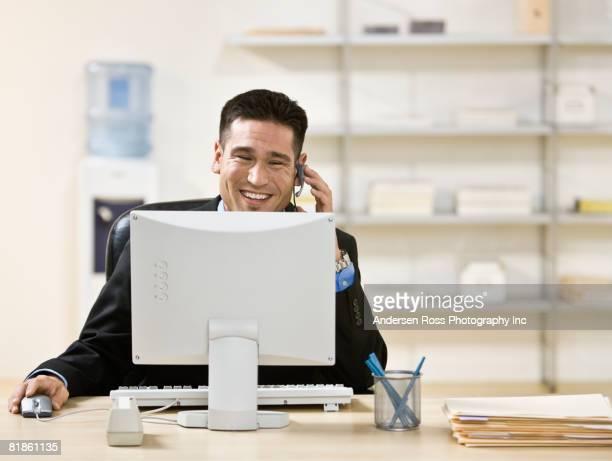 Asian businessman talking on headset