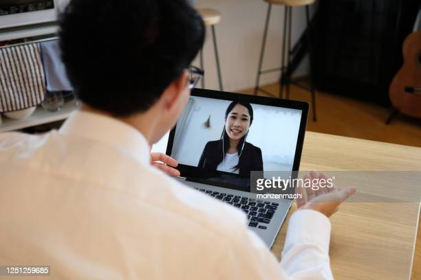 Asian businessman talking to colleague on web meeting