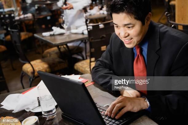 Asian businessman typing on laptop