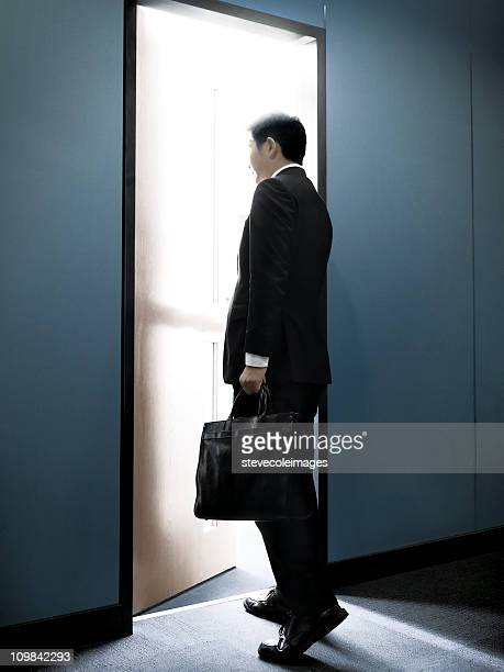 Asian Businessman Walking into an Office