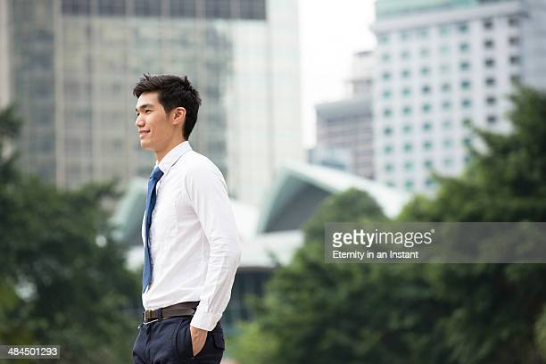 asian businessman walking outdoors. - overhemd en stropdas stockfoto's en -beelden