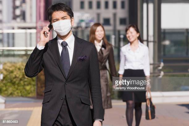 Asian businessman wearing pollution mask