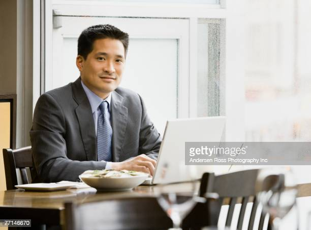 Asian businessman working at restaurant