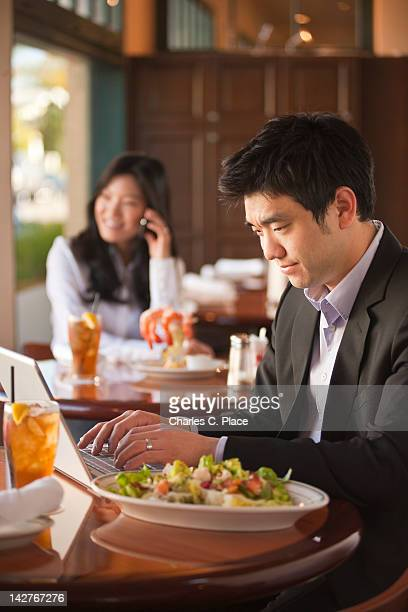 Asian businessman working remotely in a restaurant